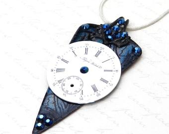 Dark, dramatict Necklace with stormy deep blue background, vintage Bijou Watch Company pocket watch dial, and Swarovski Crystal