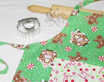 Gingerbread Houses and Cookies Child Apron - Green with Candy Pocket