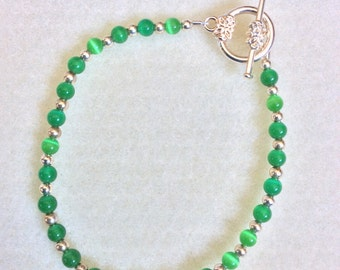 Green cats eye and silver beaded bracelet
