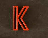 """Vintage Industrial Letter """"K"""" Black with Red and Green Paint, 2"""" tall (c.1940s) - Monogram Display, Shadow Box Letter, Art Supply"""