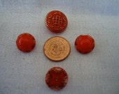 """4 Very small red glass buttons with gold highlights. 1 pair, 2 singles. All self shank and under 1"""" inch. UNK11.2-14.12-27."""