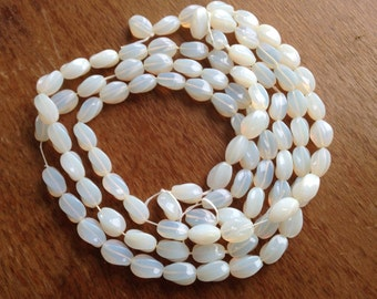 Vintage Bohemian Czech Glass Opalescent Beads on the Hank - New Old Stock