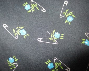 3/4 + yds. Vintage black with safety pins and turquoise flowers
