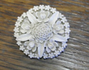 antique carved earl plastic brooch