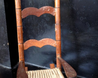 Beautiful vintage miniature cane and wood rocking chair dollhouse furniture
