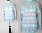 Vintage 1990s pastel blue pink DUCK and HEART print metallic sweater jumper