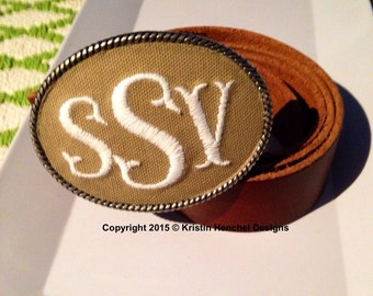 Kristin Henchel custom women's monogram belt buckle - fish tale monogram. Tan fabric with white thread