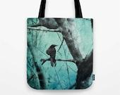 Ghostly - crow raven black bird, grungy aqua blue tote bag, gray tree