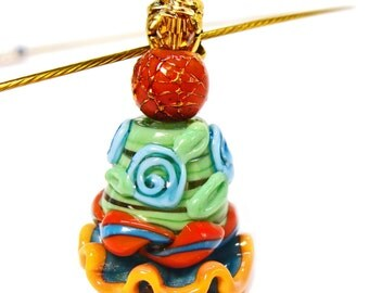 Moroccan Sand and Aqua Ruffle Bead with Sunset Orange, green and Blue Swirl Lampwork Beaded Pendant on a Gold Toned Metal Cord Hoop Necklace