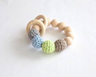 Natral beige, grey, baby blue, green ring toy with crochet wooden beads. Rattle for baby.