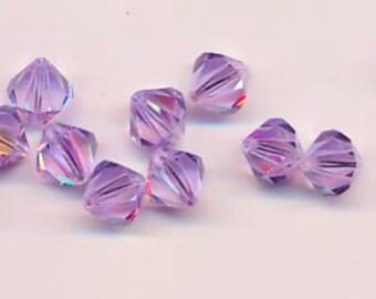 Twelve sparkling Swarovski crystals in the discontinued shape 5301: 10 mm - violet AB