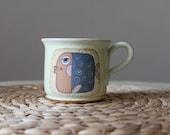 Coffee mug with a blue eyed fish
