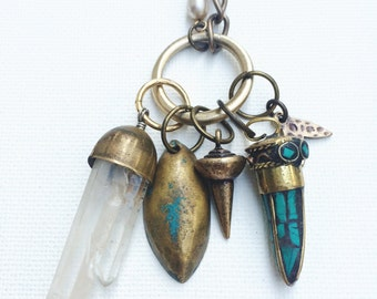 Green Curiosities Necklace -- stone horn pendant, assorted metal charms, crystal quartz points & reclaimed chain necklace