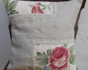 Patchwork linen cushion cover with a red rose