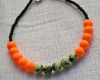 Speckled Mint Czech Glass, Neon Orange Rubberized Glass, and Matte Black Seed Beaded Bracelet