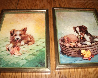 """Two Vintage, Framed, """"Puppies"""" pictures by FLORENCE KROGER."""