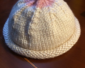 Handknitted Boob Hat for newborns.