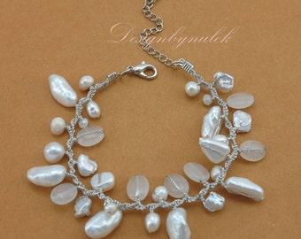 White freshwater pearl,crystal,quartz on silk bracelet.