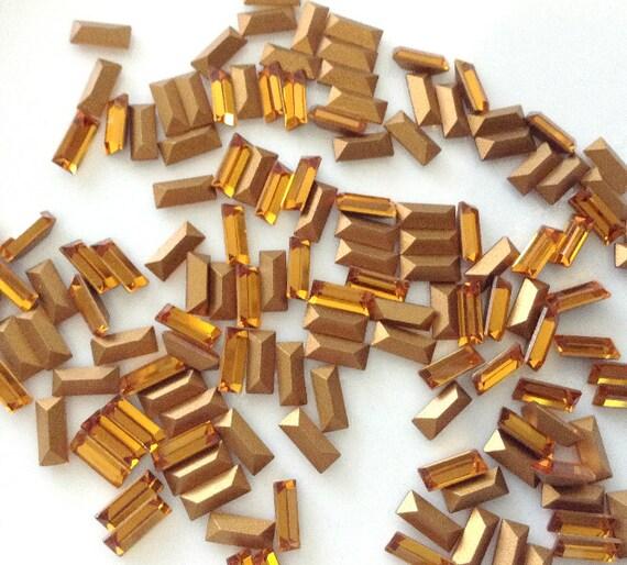12 pc Vintage 4501 Swarovski  Art 109, 7 x 3 mm Topaz Gold Rectangle Baguettes Circa 1950's sliver thin Gold Foil
