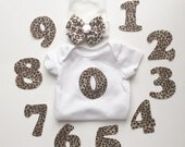 12 month newborn gift set with hospital hat and monthly baby photos applique iron on numbers in leopard print