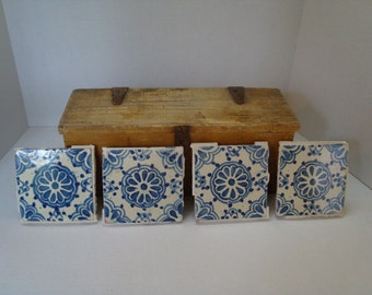 Four Vintage Blue and White Clay Tiles