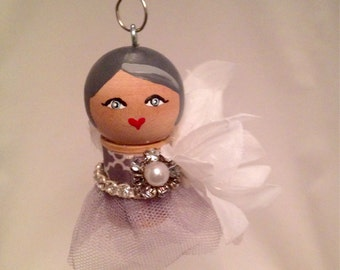 Spool doll ornament, flowers and bling