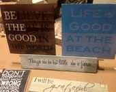 Hand painted signs on reclaimed wood. Victoria, BC Vancouver Island