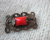 Vintage carved metal and red stone brooch
