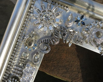 Picture frame with rhinestone embellishments.