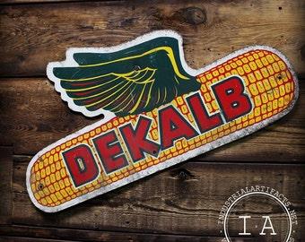 Vintage DeKalb Flying Ear Corn Seed Advertising Masonite Sign Facing Right