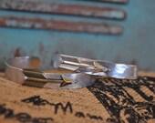 Adjustable aluminum and brass ARROW cuff