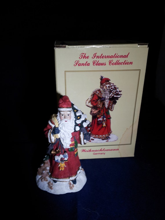 International santa claus collection figurine by
