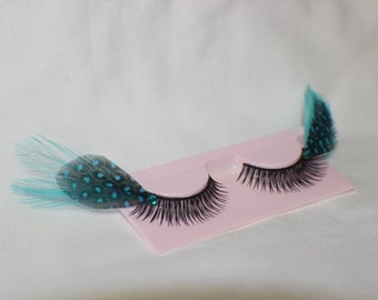 Turquoise and black feather lashes with turquoise jewels