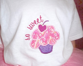 Sweet cupcake design on a body suit or toddler shirt, bib, or burp cloth.  Colors can be customized.