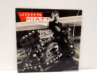 JOHN HIATT Vintage Vinyl Record Album Riding With The King Guitarist Vocalist Pop Rock and Roll Music Singer Songwriter Mohawk Music Special