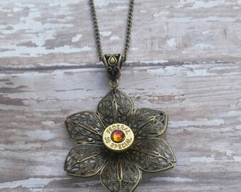 """Bullet flower necklace with bronze 18"""" chain.  Many calliber options to choose from."""