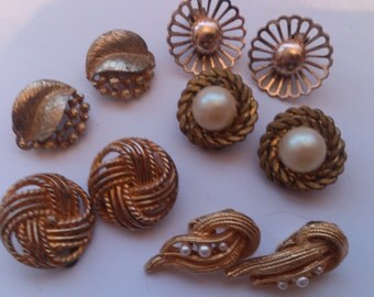 Five pairs of vintage clip on earrings