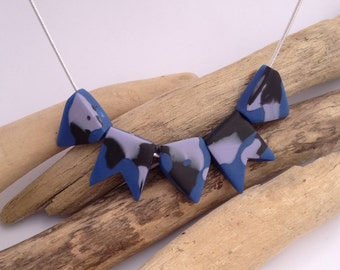 Blue abstract eco-resin bunting necklace on sterling silver chain