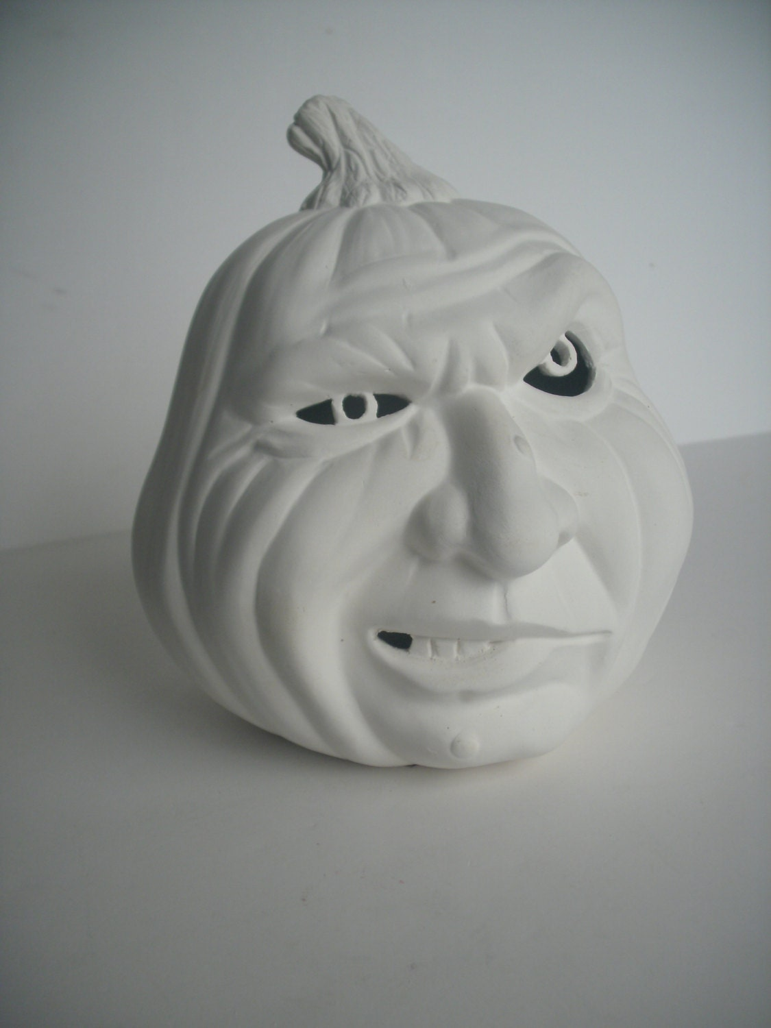 diy do it yourself ceramic halloween pumpkin with mean face