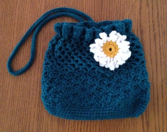 Teal purse with white flower.