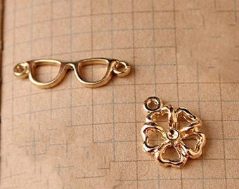 20 pcs of antique gold glasses or hollow flower charm pendants