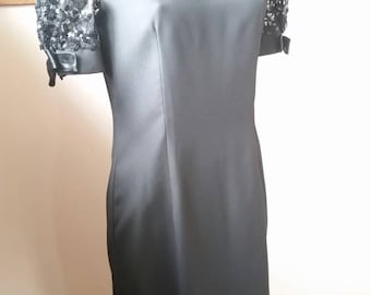 Laura K Black polyester evening dress with sequin sleeves and black satin bow ties size 10 made in Australia