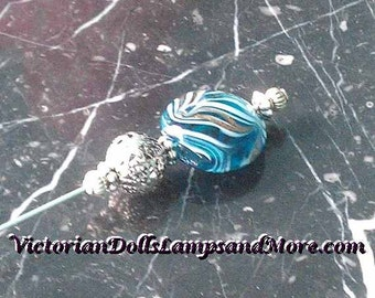 Hat Pin 5 inch with Turquoise glass sparkles bead in silver finish only 10 dollars
