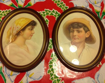 Vintage peasant boy and girl framed portraits