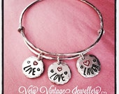 Handstamped adjustable rustic bangle with small personalised 'live, love, laugh' charms