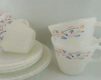 Termocrisa, Mexico, 13 Pieces: 4 Cups, 3 Saucers, 2 Mugs, 2 Plates, 2 bowls, blue and pink on white milk glass