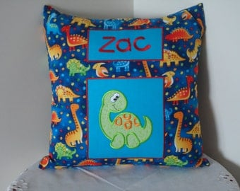 Personalised cushion cover- colourful dinsoaurs on a blue background
