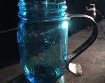 Hand forged handle with small mouth pint sized Ball jar blue glass and forged removable handle