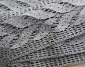 Large metallic silver trimming/edging with leaf motif. Wholesale quantity