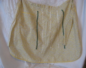 Cute  vintage yellow apron with green and white trim and detail